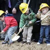 From left: Sam Miklovic, 4; Jacob Hydar, 4; and Gwendalyn Rensing, 3, participate in the groundbreaking ceremony for the Affton School District Early Childhood Education Center renovation at 9832 Reavis Road. photo by Diana Linsley
