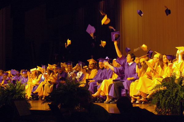 Caps fly as the Affton High School class of 2011 graduates. Credit Sarah Worner