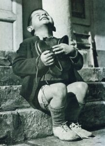 Life Magazine, 1946: An orphan with his first pair of new shoes.