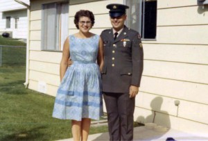 Joe and Martha in front of their home.